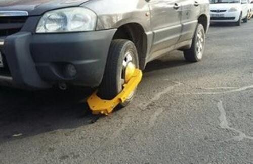 На неправильно припаркованные авто предложили ставить блокираторы